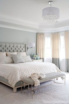 Pale grey walls + pale peach bedding + drapes in a combination of the two colors. Add a thick carpet, a bench & a great chandelier. The total adds up to glam! .....V