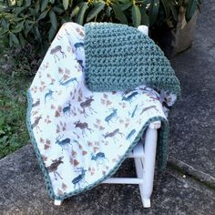 A fun hunting camo baby boy blanket. I love the fun moose and deer. The crochet side is a mossy green color.