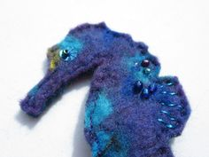 Colourful Seahorse Brooch. Hand-stitched from scraps of handmade wool felt  - every one is unique. Seem more by LittleDeb on Etsy, Facebook and Pinterest. Colorful Seahorse, Hand Stitching, Wool Felt, Scrap, Brooch, Facebook, Unique, Handmade, Etsy