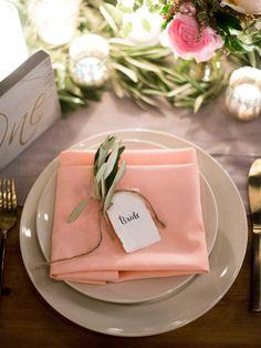 Simple ivory plates, peach napkin, twine-tied greenery bundle, wedding place setting // Erich McVey Photography