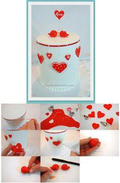 http://www.mycakeschool.com/blog/valentine-cake-with-love-birds-a-blog-tutorial/