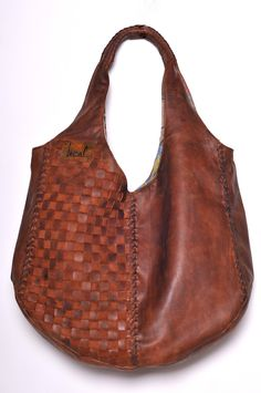 Oversized leather tote [love the woven detail]