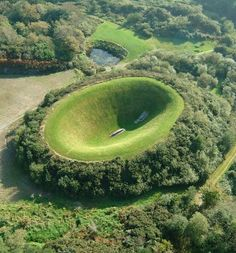 """Irish Sky Garden"" at the Liss Ard Estate, County Cork, Ireland - photo from publicart.ie; Liss Ard (also Lios Aird) contains 150 acres of gardens, trails, pools, woodland walks, and 'garden rooms.' The giant earth and stone art work ""Irish Sky Garden"" was created by James Turrell. The 'bowl' of the 162' x 82' crater is accessed by a long megalithic-like passage. http://www.publicart.ie/main/directory/directory/view/irish-sky-garden/c3d8dc7a8a615d82fb98988577463ede/"