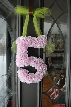 cupcake liner bday wreath - Cute with a Pink and blue  and a Big Blue\pink Ribbon!