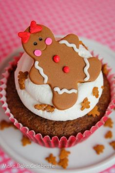 Gingerbread Girl*1 box Betty Crocker gingerbread cake mix,1 pkg gingerbread Oreo,1 egg,1 1/4 c water.Pull top off 12 cookies,use half w/icing& lay them icing side up in eh cupcake liner.Mix egg,water & cake mix together. Spoon 3 Tb of batter in eh cupcake liner over oreo.Bake 350,18 mins.Frost w/Buttercream Frosting.Add Gingerbread topper *made of fondant.Royal icing to decorate.Sprinkles,edible marker for eyes.Use the end of icing tip to make mouth.