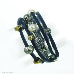 This bracelet uses both leather and the silver Trollbeads chains together.  LInk to the blue leather bracelet! http://www.trollbeadsgallery.com/leather-bracelet-blue/