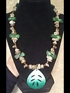 Really unique and ready for Spring! Green Coral, Polished Shells, Copper Crystals & Leaf Accents. $35