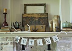 Gorgeous vintage fall mantel - love the suitcases and layering of pieces