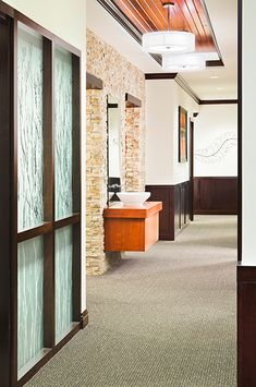 Stone wall, ceiling/lighting  Trent Redfearn, DDS - Dental Office Design by JoeArchitect in Highlands Ranch, CO