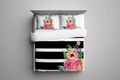 This beautiful and elegant Black & White StripesFloralduvet coverwill make any bedroomin your home look amazing and luxurious. Pillow Shams sold separat