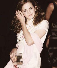 Curling haired Emma Watson 2013...
