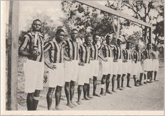 Colonial times, a French colony perhaps. African continental footballers with trophy. Postcard image, c.1950s.