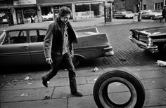 Bob Dylan, rolling a tire, NYC, 1963 // from Jim Marshall's Musician Portraits