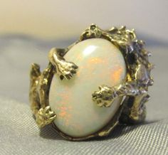 """Dragon hugging an opal - maybe this should go on my """"Irresistible creatures"""" board instead!"""