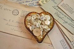 buttons in a heart shaped dish