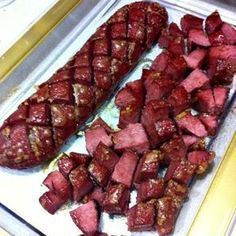 This Baked Salami is ALWAYS a huge hit! It is a GREAT and easy appetizer to bring for Thanksgiving, Christmas, Superbowl - ANYTHING! appetizers to bring Our Famous Baked Salami Recipe - 3 Ingredients and always a HUGE HIT! Salami Appetizer, Finger Food Appetizers, Appetizers For Party, Camping Appetizers, Delicious Appetizers, Cold Appetizers, Appetizer Ideas, Easy Appetizer Recipes, Baked Salami Recipe