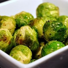 ****Roasted Brussels Sprouts - Allrecipes.com  Half sprouts, place cut side down on cookie sheet.  bake at 425 for 20-30 minutes.