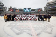 The New York Rangers pose for a team photo before the start of the 2014 NHL Stadium Series