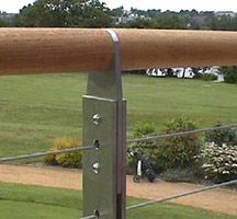 External balcony with tensioned cable balustrades incorporating straining wires fixed with bottle screws and teak handrail. By John Desmond Steel Balustrade, Wood Handrail, Glass Balustrade, Staircase Railings, Wood Stairs, Deck Railings, Staircases, Stainless Steel Staircase, Garden Railings
