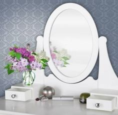 White make-up table with mirror.