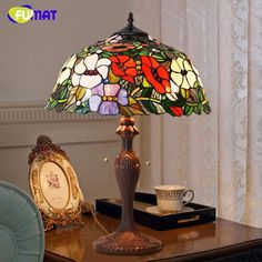 Finding the best lamp for your home can be challenging because there's such a wide range of lamps from which to select. Discover the perfect living room lamp, bedroom lamp, desk lamp or any other style for your specific area. Stained Glass Lamp Shades, Stained Glass Rose, Stained Glass Panels, Stained Glass Table Lamps, Antique Lamps, Vintage Lamps, Antique Art, Lampe Art Deco, Tiffany Table Lamps