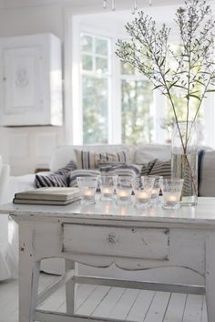 Shabby Chic - i like these taller coffee tables.