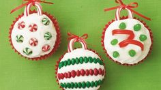 Holiday Ornament Cupcakes Recipe Desserts with white cake mix, water, egg whites, vegetable oil, powdered sugar, butter, vanilla, milk, candy canes, jelly beans, candy, red string licorice, candy coated chocolate, sunflower seeds