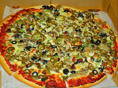 Olive salad pizza