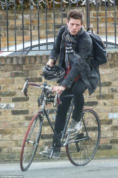 Keeping fit: James Norton took to the streets alone last week as he cycled to the shops from his south London home