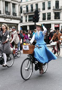 She looks fabulous! Mary Poppins couldn't do it better. ->London Tweed Run 2013 Winner: Most Dashing Dame