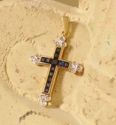 #WeBuyGoldBoutique ~ Starting bid $161.95 Estate Deep Blue Sapphire and Diamond 14K Yellow Gold Cross Pendant. Visit our website WeBuyGoldBoutique.com to bid. #Gold #BlueSapphire #Diamond #Cross #Pendant #Jewelry #FineJewelry #Necklace #14k #Boutique