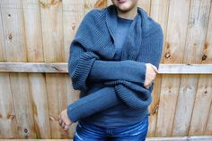 This dark grey Hand-Knit Sleeved Scarf features the newest innovation in knit scarves: SLEEVES! The warm knit will keep your neck, face, and head snug and cozy while the optional sleeves can be used to add warm for your arms. The classic and simple style of this Sleeved Scarf makes it a perfect accessory for your Fall and Winter wardrobe. Wear it as a shawl around your shoulders with your arms in the sleeves, or triple wrap it around your neck for a classic scarf look, or even wrap it…