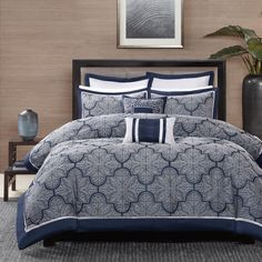 The Madison Park Barrett Collection provides a unique update to your bedroom. Its woven jacquard fabrication uses silver/gold thread on a navy blue/black base creating a beautiful key design on your top of bed.