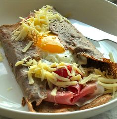 savory crepes with egg, emmental cheese, iberico ham and mushrooms cooked in cream and butter