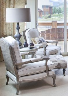keeping it simple | neutral + bergere chairs + lamp + ottoman  I adore Bergere chairs!