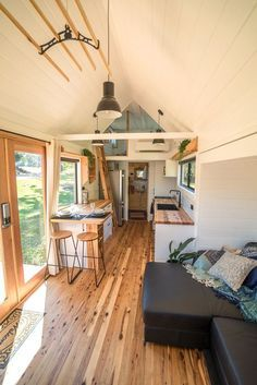 Sojourner by Häuslein Tiny House Co - Tiny Living Inside the Sojourner are bea. Sojourner by Häuslein Tiny House Co – Tiny Living Inside the Sojourner are beautiful cypress pi Tiny Houses For Rent, Best Tiny House, Modern Tiny House, Tiny House Listings, Tiny House Plans, Tiny House Design, Bedroom Storage For Small Rooms, Tiny House Storage, Laundry Storage