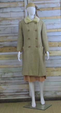 This coat is beautiful, such a classic, simple yet glamorous style indicative of the 60s.    amazing Irish wool with faux fur collar, https://www.etsy.com/listing/207114419/1960s-wool-blonde-jaeger-coat-m?ref=listing-shop-header-3