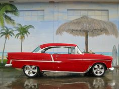 Red 55 Chevy ...reminds me of my dad's black 55 with the license plate RATON55, good memories!!