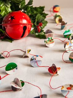 Have a lot of old holiday cards? Make a colorful garland for your tree, mantle, or tabletop. #Christmas #DIY