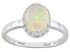 I like solitare rings a lot. They have a look of sophistication about them. Opals and moonstones have a kind of hypnotic effect to me.
