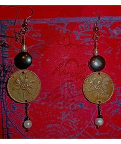 VINTAGE JAMAICA 1970'S 1 CENTS WITH PEARLS AND HEMATITE  http://www.thesoulshoppe.com/earrings/1347-vintage-jamaica-1970-s-1-cents-with-pearls-and-hematite.html