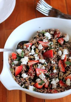 Fresh Strawberry Quinoa Salad with Goat Cheese, Sunflower Seeds & Lemon Vinaigrette. Serve over a bed of spinach leaves for packed lunches.  Also recommended to use pecans instead of sunflower seeds.