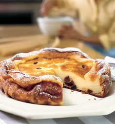 FAR BRETON:    ingredients:    2 cups whole milk  3 large eggs  1/2 cup sugar  5 tablespoons unsalted butter, melted, cooled  1/4 teaspoon vanilla extract  1/8 teaspoon salt  3/4 cup all purpose flour    1 cup small or medium-size pitted prunes (about 6 ounces)  1/2 cup water  1/3 cup raisins  1/4 cup Armagnac or other brandy      Read More http://www.epicurious.com/recipes/food/views/Far-Breton-231583#ixzz1xnajcHpH