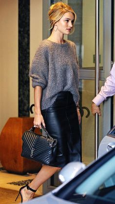 Rosie Huntington-Whiteley in a leather pencil skirt, gray sweater, YSL bag, and heels - click through for more fall outfit ideas