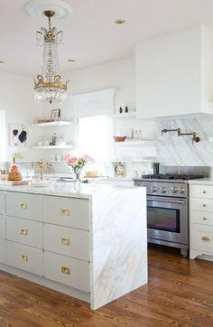White marble with a chandelier | Kitchens We Love
