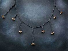 Hey, I found this really awesome Etsy listing at https://www.etsy.com/listing/205517112/asymmetric-bronze-seeds-925k-oxidized