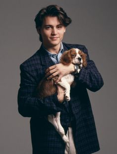 Johnny Depp when he was just a wee boy...and puppy. Because, ya know, why wouldn't Johnny Depp be holding a puppy?