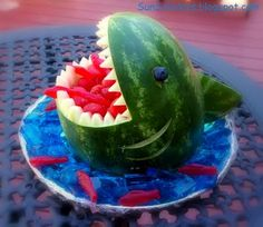 Awesome easy shark to make out of a watermelon, jello, and swedish fish! So cute for a pool party. Shark is swimming in blue water (jello)