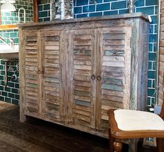 distressed cabinet with shuttered doors. love the washed out gray & aqua colors. #beach