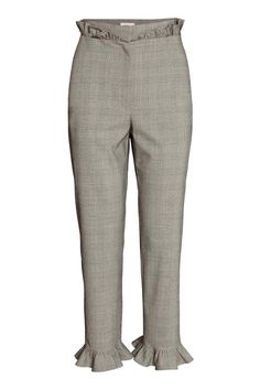 Trousers with frills: Ankle-length trousers in woven fabric with frill details, a high waist with a hook-and-eye fastener, a zip fly, welt back pockets and tapered legs.